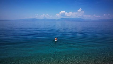 <strong>Derveni, Greece: </strong>A boy paddles his boat in the clear waters off Derveni, a coastal town some 120 kilometers southwest of Athens.