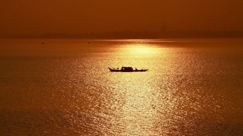 <strong>Phnom Penh:</strong> In the Cambodian capital, a fishing boat travels at sunrise along the Mekong River. <br />