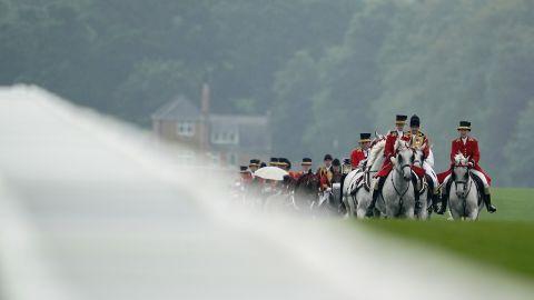 The Royal Procession makes its way down the Straight Mile at Royal Ascot ahead of racing.
