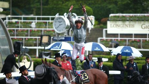 Veteran Italian jockey Frankie Dettori treats the crowd to his trademark flying dismount after clinching his 61st winner at Royal Ascot in the opener.