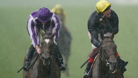 The heavens opened later Wednesday as Frankie Dettori rode Crystal Ocean (right) to victory in the showpiece Prince Of Wales's Stakes.