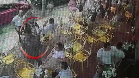 Surveillance camera video shows Sixto Fernandez arriving at the club.
