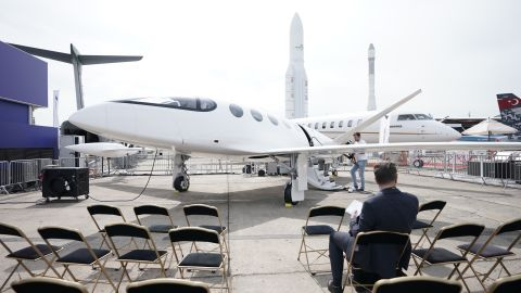 A visitor to the Paris Air Show looks at the Alice electric aircraft manufactured by Eviation Aircraft.