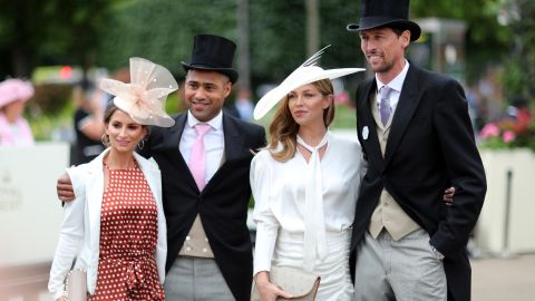 Premier League footballers Peter Crouch (right) and Glen Johnson with their wives on Ladies' Day.