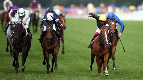 Frankie Dettori (yellow cap) and Stradivarius hold off Dee Ex Bee and Master of Reality to clinch a famous win on  Ladies' Day at Royal Ascot.