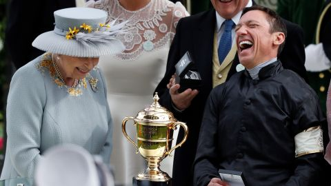 Britain's Queen Elizabeth II presents jockey Frankie Dettori with the Gold Cup after his second straight win on Stradivarius.
