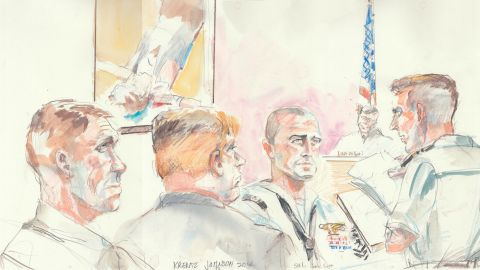 Corey Scott, a Navy SEAL medic (center with shaved head looking forward), testified Thursday in the military court trial of Chief Special Warfare Operator Eddie Gallagher who is accused of stabbing and killing an ISIS prisoner in Iraq in 2017.