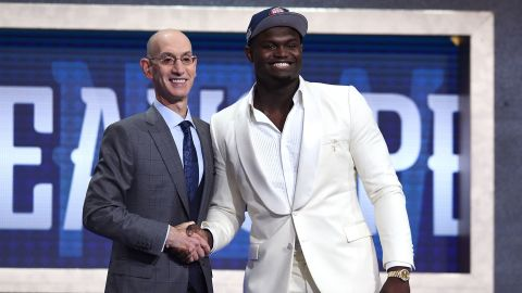 Zion Williamson poses with NBA Commissioner Adam Silver after being drafted with the first overall pick by the New Orleans Pelicans during the 2019 NBA Draft.