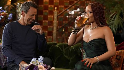 """LATE NIGHT WITH SETH MEYERS -- Episode 851 -- Pictured: (l-r) Host Seth Meyers and singer Rihanna during """"Seth and Rihanna Go Day Drinking"""" on June 20, 2019 -- (Photo by: Jon Pack/NBC)"""