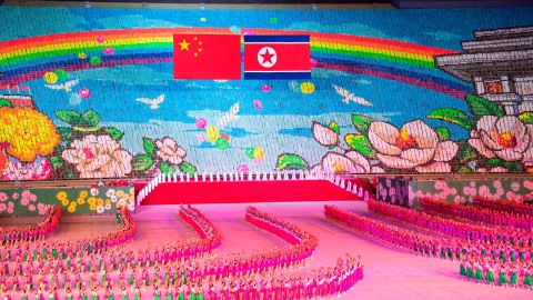 Chinese and North Korean flags are displayed during a mass gymnastic performance at the May Day Stadium in Pyongyang, North Korea.