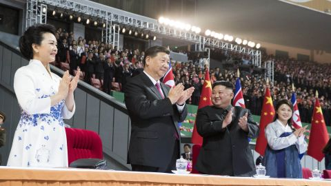 Xi Jinping, second from left, and his wife Peng Liyuan, left, and Kim Jong Un, second from right, and his wife Ri Sol Ju, right, in Pyongyang, North Korea.