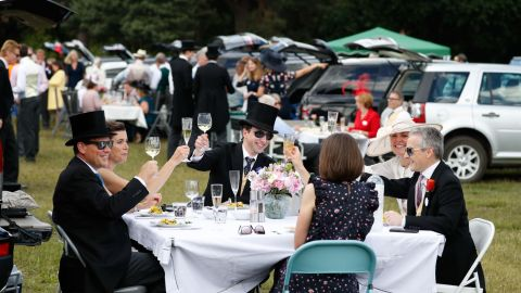 After a wet week, the sun is out at Ascot and racegoers are able to enjoy picnics in the car park.