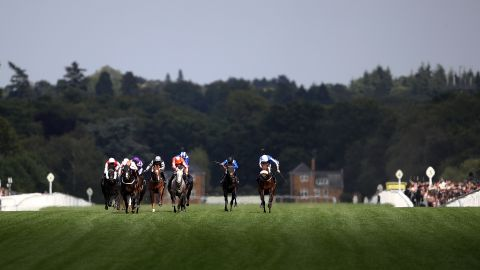 Frankie Dettori riding Advertise leads the field on the run-in in the Commonwealth Cup.