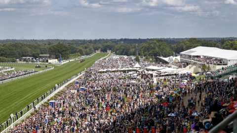 Huge crowds once again pack the historic race course in Berkshire, west of London.