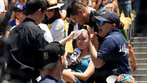 LOS ANGELES, CALIFORNIA - JUNE 23:  An injured fan is escorted on a stretcher after she was hit by a foul ball off the bat of Cody Bellinger #35 of the Los Angeles Dodgers during the first inning against the Colorado Rockies at Dodger Stadium on June 23, 2019 in Los Angeles, California. (Photo by Harry How/Getty Images)