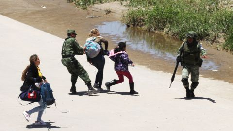 Mexican National Guard troops prevent Central American migrants from crossing the Rio Grande in Ciudad Juárez, Mexico, on June 21.