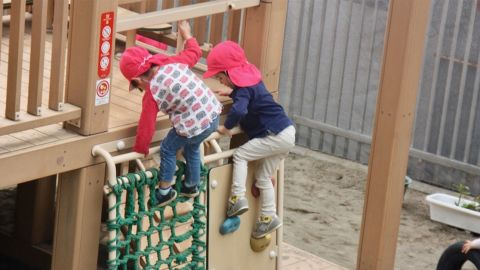 Children play on the playground at a public day care in Minato ward in Tokyo.