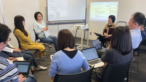 Tae Amano addresses a Sunday meeting of Miraco, the group she co-founded to advocate for better day care availability and more support for parents in Japan.