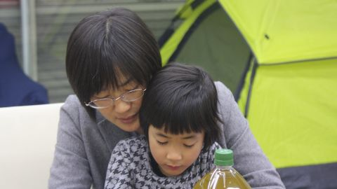 Kumamoto City Councilwoman Yuka Ogata hangs out with her daughter while waiting to meet with local moms.