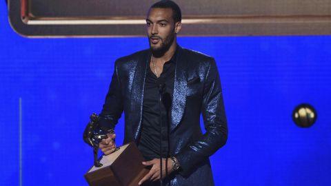 Rudy Gobert, of the Utah Jazz, accepts the NBA defensive player of the year award at the NBA Awards.