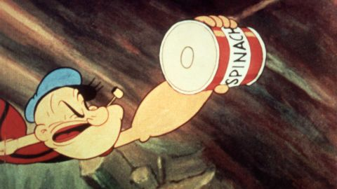 Popeye reaches for a can of spinach in a still from an unidenitified Popeye film, c. 1945. (Image by Paramount Pictures/Courtesy of Getty Images)