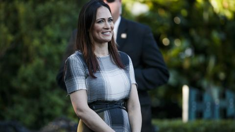 Stephanie Grisham, spokeswoman for first lady Melania Trump, watches as President Donald Trump and the first lady greet attendees during the annual Congressional Picnic on the South Lawn, Friday, June 21, 2019, in Washington. (AP/Jacquelyn Martin)
