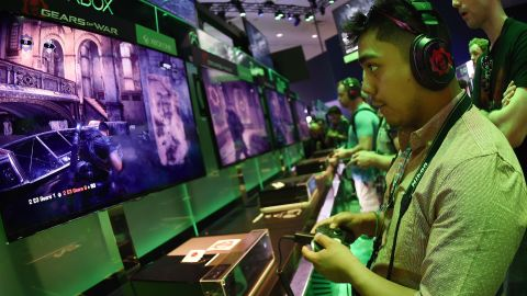 """Gamer Jonathan Martinez tests a new """"Gears of War"""" game at the Xbox display on the second day of the Electronic Entertainment Expo, known as E3 at the Convention Center in Los Angeles, California on June 17, 2015.  The expansive E3 show floor was rich with VR offerings from developers working on games for immersive head gear expected to hit the market in force next year.        AFP PHOTO / MARK RALSTON        (Photo credit should read MARK RALSTON/AFP/Getty Images)"""