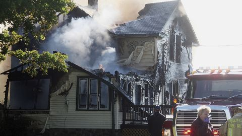 Responders work the scene of a deadly house fire in Pickerel, Wisconsin on Tuesday.