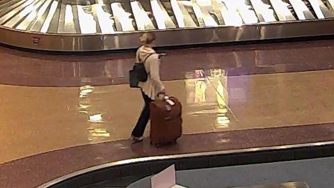Mackenzie Lueck is seen carrying her luggage through Salt Lake City International Airport.