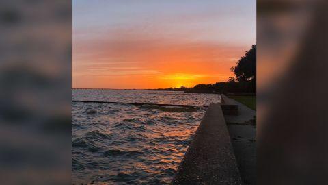 The sun sets Tuesday over Lake Pontchartrain in Louisiana.