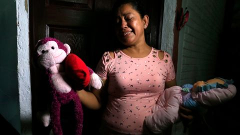 Rosa Ramirez sobs as she shows journalists toys that belonged to her nearly 2-year-old granddaughter Valeria in her home in San Martin, El Salvador, on Tuesday.