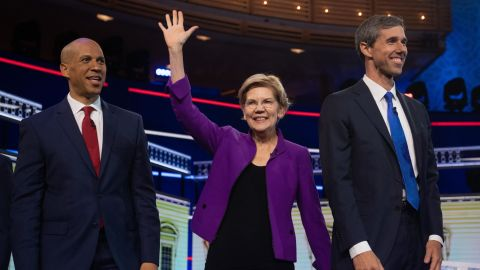 Democratic presidential hopefuls (fromL) US Senator from New Jersey Cory Booker, US Senator from Massachusetts Elizabeth Warren and former US Representative for Texas' 16th congressional district Beto O'Rourke arrive to participate in the first Democratic primary debate of the 2020 presidential campaign season hosted by NBC News at the Adrienne Arsht Center for the Performing Arts in Miami, Florida, June 26, 2019. (Photo by SAUL LOEB / AFP)        (Photo credit should read SAUL LOEB/AFP/Getty Images)