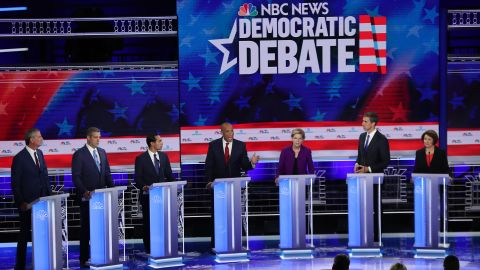 Democratic presidential candidates New York City Mayor Bill De Blasio (L-R), Rep. Tim Ryan (D-OH), former housing secretary Julian Castro, Sen. Cory Booker (D-NJ), Sen. Elizabeth Warren (D-MA), former Texas congressman Beto O'Rourke and Sen. Amy Klobuchar (D-MN) take part in the first night of the Democratic presidential debate on June 26, 2019 in Miami, Florida.  A field of 20 Democratic presidential candidates was split into two groups of 10 for the first debate of the 2020 election, taking place over two nights at Knight Concert Hall of the Adrienne Arsht Center for the Performing Arts of Miami-Dade County, hosted by NBC News, MSNBC, and Telemundo.