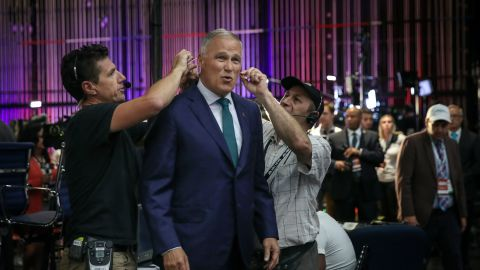 Inslee gets a microphone attached to him for a television interview in June 2019. It was just before the first Democratic debates.
