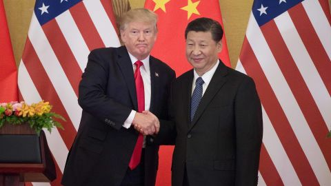"""US President Donald Trump (L) shakes hands with China's President Xi Jinping during a press conference at the Great Hall of the People in Beijing on November 9, 2017.  Donald Trump urged Chinese leader Xi Jinping to work """"hard"""" and act fast to help resolve the North Korean nuclear crisis, during their meeting in Beijing Thursday, warning that """"time is quickly running out""""."""
