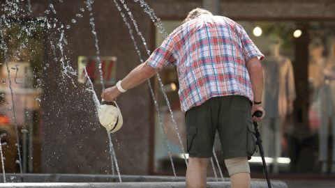 A man cools off in a water fountain at Parc de Sa Riera in Palma de Mallorca, on June 26, 2019 at the start of a heatwave tipped to break records across Europe. - Experts say such heatwaves early in the summer are likely to be more frequent as the planet heats up -- a phenomenon that scientists have shown to be driven by human use of fossil fuels. (Photo by JAIME REINA / AFP)        (Photo credit should read JAIME REINA/AFP/Getty Images)