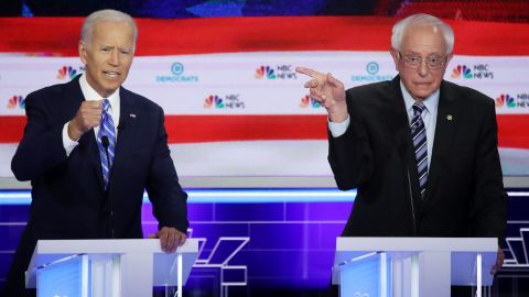 MIAMI, FLORIDA - JUNE 27: Democratic presidential candidates former Vice President Joe Biden and Sen. Bernie Sanders (I-VT) speak during the second night of the first Democratic presidential debate on June 27, 2019 in Miami, Florida.  A field of 20 Democratic presidential candidates was split into two groups of 10 for the first debate of the 2020 election, taking place over two nights at Knight Concert Hall of the Adrienne Arsht Center for the Performing Arts of Miami-Dade County, hosted by NBC News, MSNBC, and Telemundo. (Photo by Drew Angerer/Getty Images)