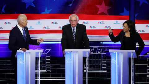 MIAMI, FLORIDA - JUNE 27: Sen. Kamala Harris (R) (D-CA) and former Vice President Joe Biden (L) speak as Sen. Bernie Sanders (I-VT) looks on during the second night of the first Democratic presidential debate on June 27, 2019 in Miami, Florida.  A field of 20 Democratic presidential candidates was split into two groups of 10 for the first debate of the 2020 election, taking place over two nights at Knight Concert Hall of the Adrienne Arsht Center for the Performing Arts of Miami-Dade County, hosted by NBC News, MSNBC, and Telemundo. (Photo by Drew Angerer/Getty Images)