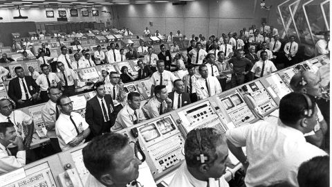 Members of the Kennedy Space Center control room team rise from their consoles to see the liftoff of the Apollo 11 mission 16 July 1969.  AFP PHOTO/NASA (Photo by NASA / NASA / AFP)        (Photo credit should read NASA/AFP/Getty Images)