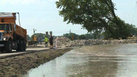 A crew works to repair a levee near Jefferson City, Missouri.