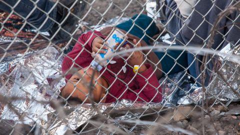 US authorities are no longer holding migrants under a border bridge here.