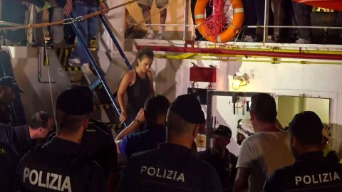 Carola Rackete is arrested after disembarking from the vessel.