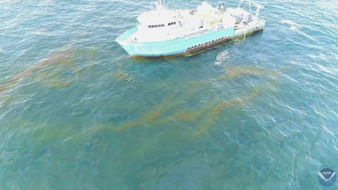 This September 2018 photo provided by NOAA shows a NOAA research vessel at a Taylor Energy production site in the Gulf of Mexico. A federally led study of oil seeping from the damaged platform found releases lower than other recent estimates, but contradicts the well owner's assertions about the amount and source of oil.