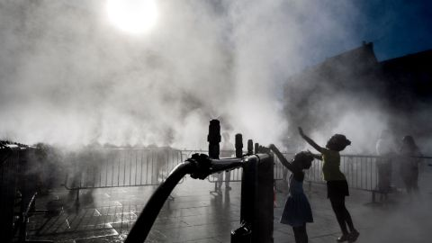 Children play next to a water atomizer on a central square in Strasbourg, eastern France on June 28, 2019. - The temperature in France on June 28 surpassed 45 degrees Celsius (113 degrees Fahrenheit) for the first time as Europe wilted in a major heatwave, state weather forecaster Meteo-France said. (Photo by PATRICK HERTZOG / AFP)        (Photo credit should read PATRICK HERTZOG/AFP/Getty Images)