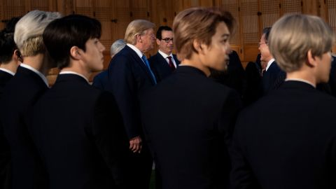 Members of K-pop band EXO stand while President Donald Trump, Treasury Secretary Steven Mnuchin and South Korean President Moon Jae-in wait at the presidential Blue House in Seoul on Saturday, June 29.
