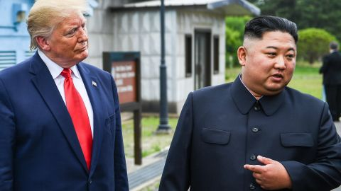 North Korea's leader Kim Jong Un speaks as he stands with US President Donald Trump south of the Military Demarcation Line that divides North and South Korea, in the Joint Security Area (JSA) of Panmunjom in the Demilitarized zone (DMZ) on June 30, 2019.