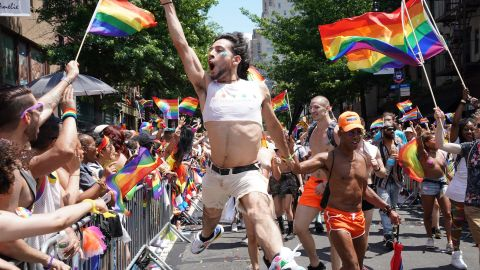 An exuberant marcher leaps in the air during the New York City Pride March.