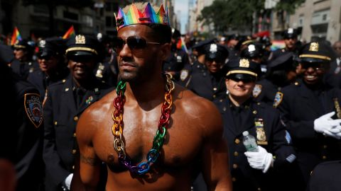 A man walks with New York City Police officers as they take part in the parade.