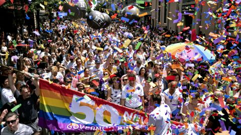 New York Gov. Andrew Cuomo, lower front center, marches with thousands of other participants of the New York City Pride March.