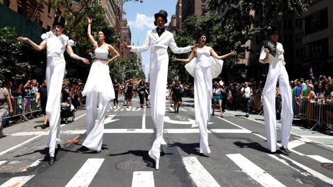 Parade participants march while wearing stilts during the New York City Pride March as part of WorldPride on Sunday, June 30.